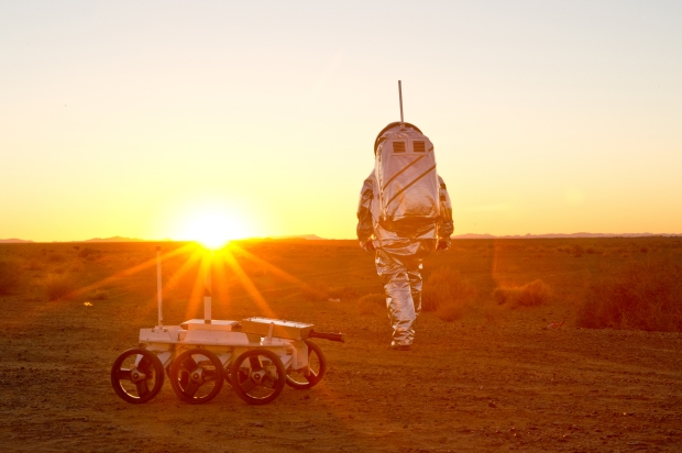 Aouda.X Mars spacesuit together with  Polish MAGMA White rover during sunset.  (c) OeWF (Katja Zanella-Kux)